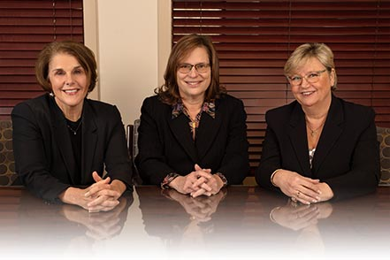 Juliane Soprano, Sally Clymer and Lisa S. Carlson sitting at a table